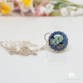 Joining this week's necklace parade is a glass cabochon set in a sterling & fine silver bezel.