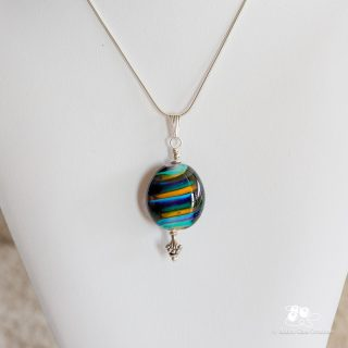 A simple flat oval drop with a beautiful rainbow of colours and silver findings and chain.