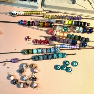 Getting organized! or so it would seem.  I like to play with my beads so I layout them out on my work bench and start playing with size and colour.  These beads may become bracelets, or necklaces, or earrings.  Stay tuned!